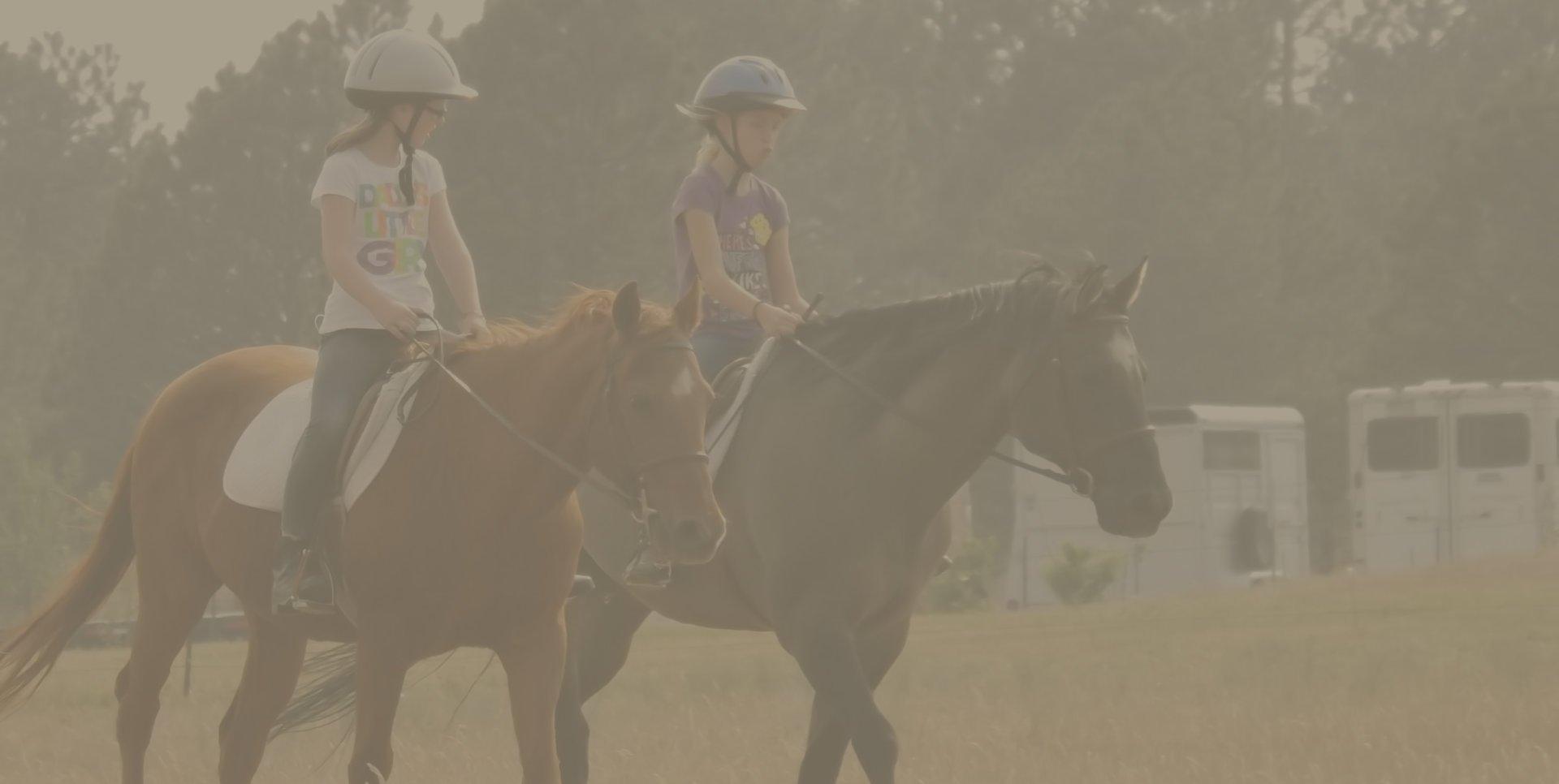 Riding horses image