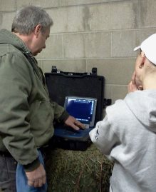 Dr. Woodall checking equine digital ultrasound